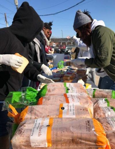 Race 4 Achievement volunteers making sandwiches