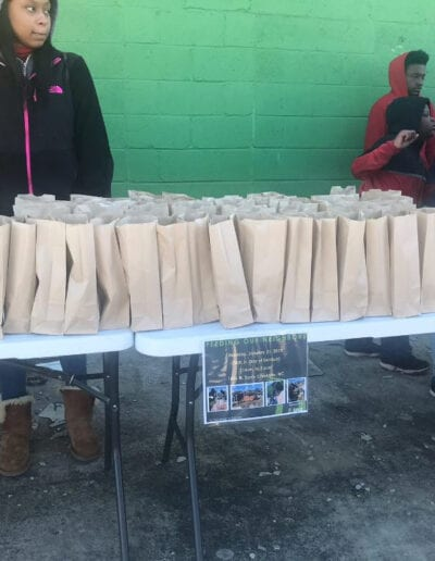 Race 4 Achievement volunteers with bag lunches