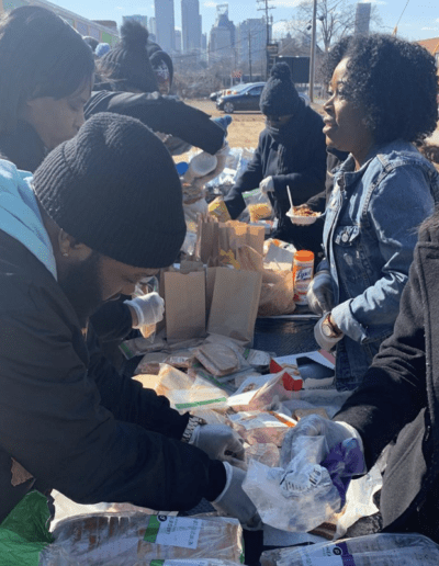 People making bag lunches